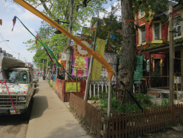 This is a photograph showing front yards and storefronts on Kensington Avenue
