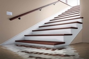 Image of basement stairs with water flooding the floor.