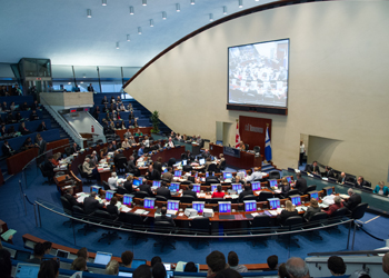 Interior of City Council Chambers at Toronto's City Hall showing seating for Councillors and seating in the public gallery