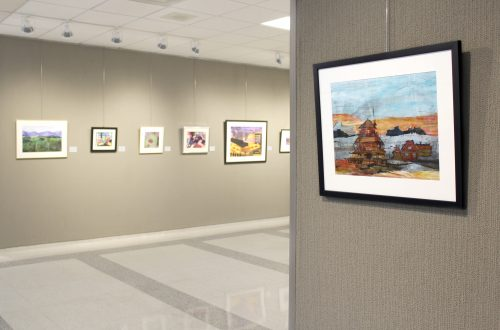 Paintings of various sizes hanging on the walls