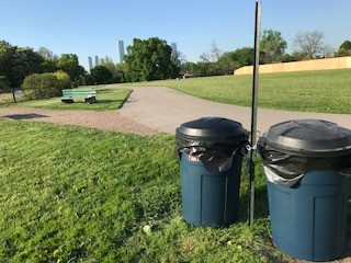 Picture of the temporary garbage bins that are small round bins with lids