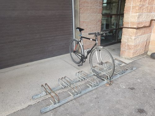 A bicycle parking rack that only allows locking to the wheel and not the frame