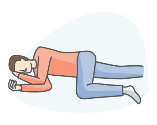 person laying in recovery position on side, head supported
