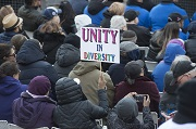 A person holding a sign reading Unity in Diversity at the Toronto Strong vigil