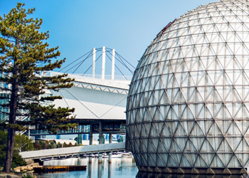 Photo of the Ontario Place Cinesphere building on Toronto's waterfront a white dome surrounded by water