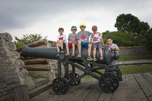 children on historic cannon