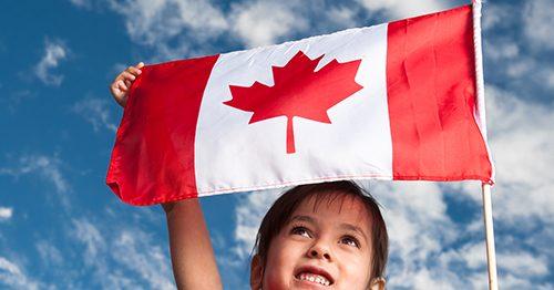 child holding Canadian Flag