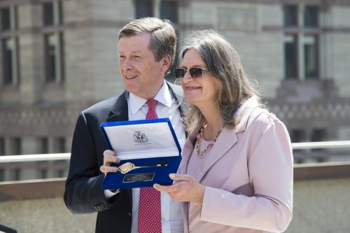 Susan Gapka is presented with the key to the City by Mayor Tory