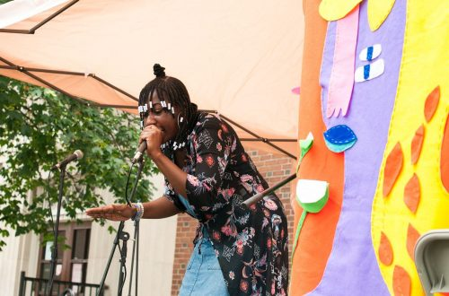 performer in a colourful tent