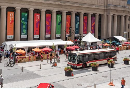 Bus in front of Union Station. Market in background.