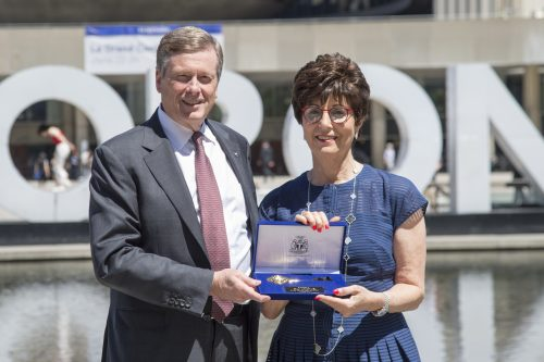 Fran Sonshine is presented with the Key to the City by Mayor Tory