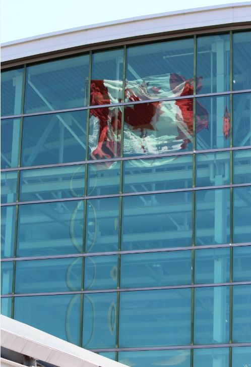 Canadian Flag reflected in building glass