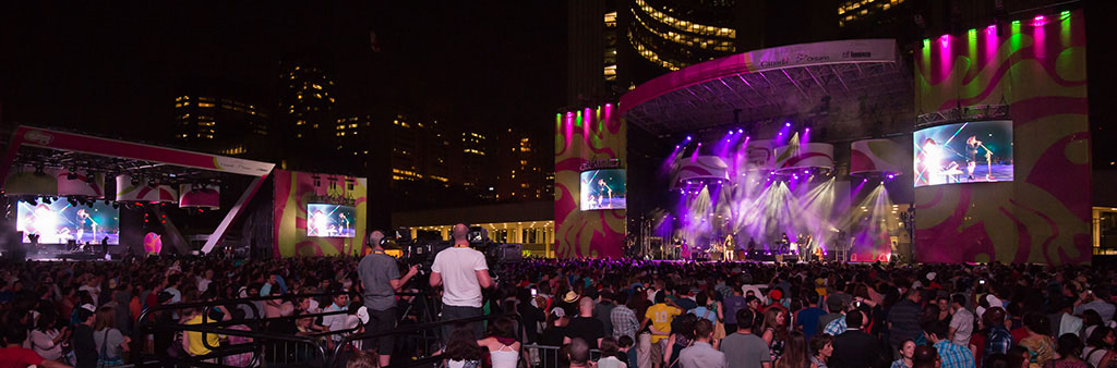 Serena Ryder on stage with large crowd at Panamania