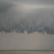 Storm clouds loom over beach