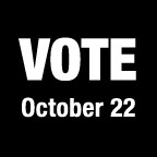 Black box with white text reading VOTE October 22