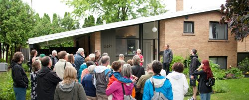 people on walking tour - in front of modern building Image info: Modern TO Bus Tour. Credit: Herman Custodio.