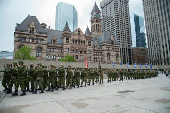 Canadian Armed forces regiment marching on Nathan Philips Square towards Toronto City Hall as they receive their Freedom of the City honour.