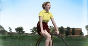 Picture of a woman riding a unicycle in the 1950s