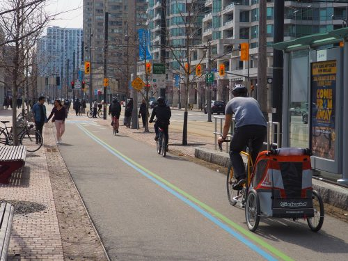 Cyclists using the shared Martin Goodman multi-use trail through downtown.
