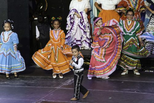 children performing in colourful, traditional costumes