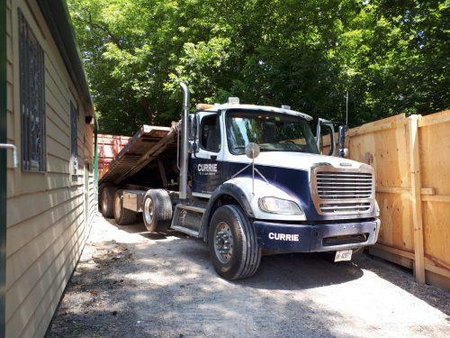 truck inside Rosehill hoarding near ravine and Avoca