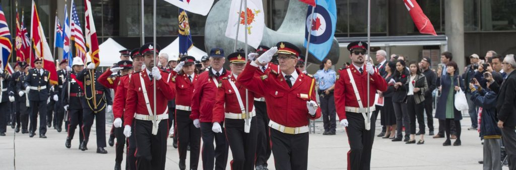 City of Toronto Honour Guard marches in Nathan Phillips Square