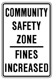 Image of a white and black sign reading, community safety zone, fines increased.