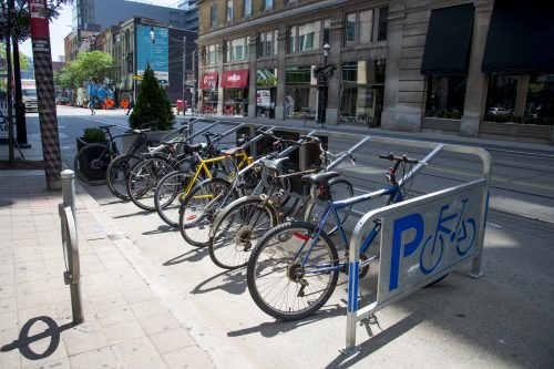 bikes parked in new bike corral on curb lane