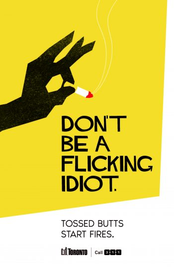 "poster with graphic of a hand holding a cigarette and copy that says ""Don't be a flicking idiot. Tossed butts start fires."""