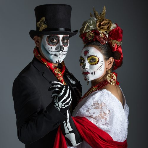 Day of the Dead - people in costumes, painted faces.