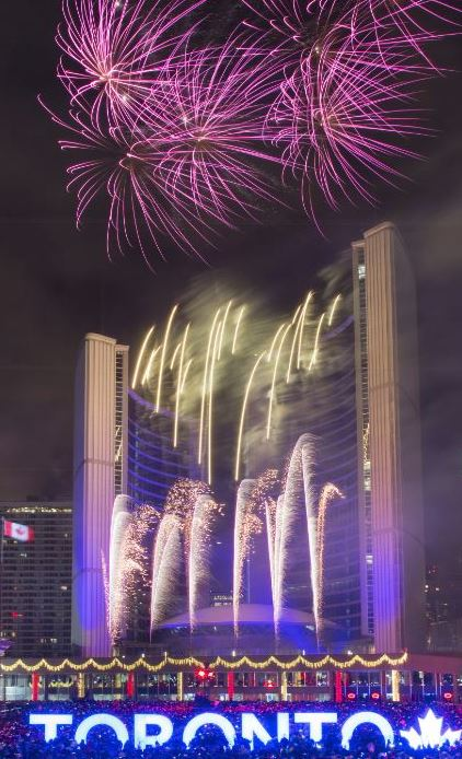 Fireworks for Cavalcade of Lights - City Hall in background, Toronto Sign in foreground