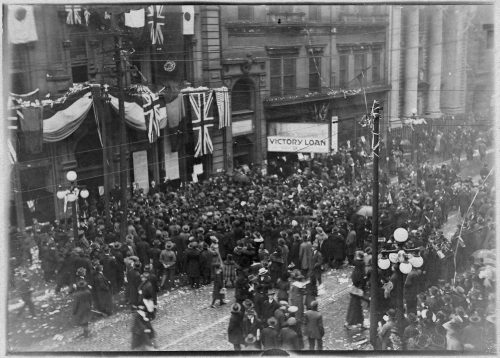 Crowds of people on King Street celebrating Armistce Day