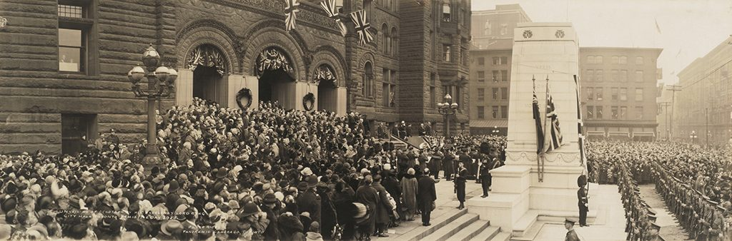 Lord Byng unveiling Old City Hall cenotaph, surrounded by large group of soldiers, civilians and government officials