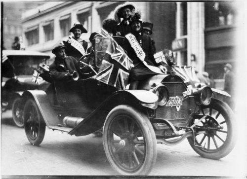Armistice Day celebrants with Union Jacks in car