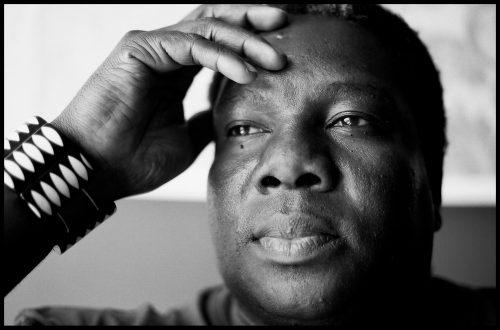 Vusi Mahlasela - closeup on mans face, hand by head