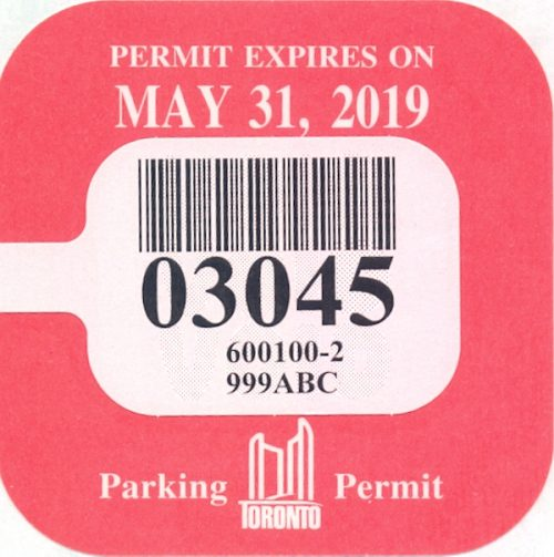 A pink parking permit renewal sticker reading: Permit Expires May 31, 2019