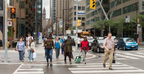 Image of pedestrians crossing the street.