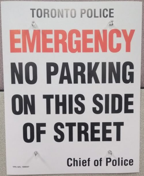 Example of Construction signage Toronto Police which states no parking on this side of the street