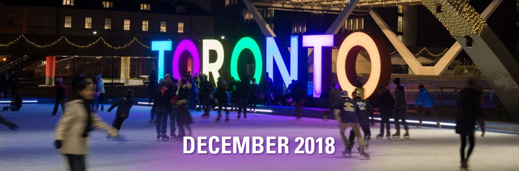 """Skaters in front of the Toronto sign with text reading """"December 2018."""""""