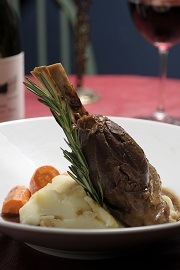 A plated lamb shank dinner.