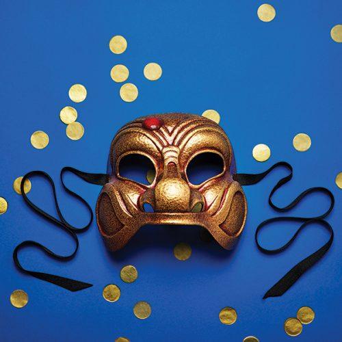 Gold mask, blue background.