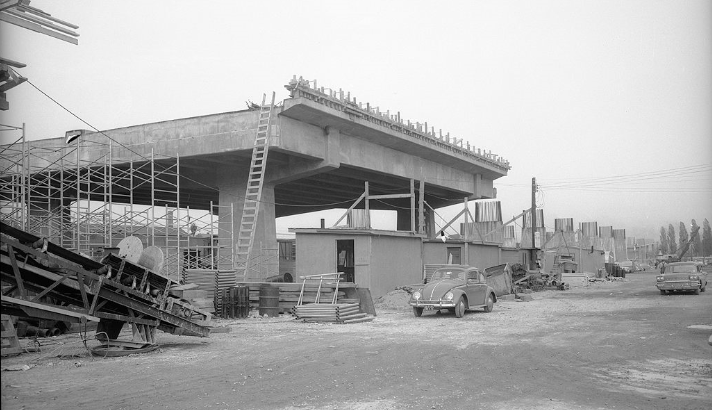 Cars drive by a partially built Gardiner Expressway in this photo from the late 1950s