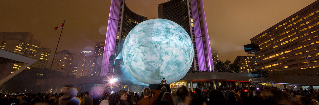 Nuit Blanche Toronto 2016: People gathered around Director X's Death of the Sun art installation at Nathan Phillips Square.