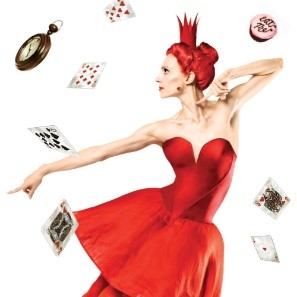 Ballerina in red dress and crown. White background.
