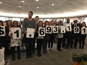 City staff at wrap up event reveal total amount raised for 2018 UW employee campaign.