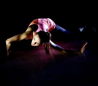 dancer, contorted, on hands and knees.