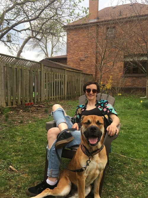 Second Chance Dog Austin sitting happily with his new human partner
