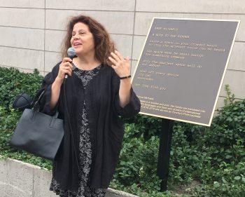 Anne Michaels unveils a plaque