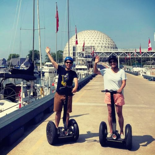 People riding segways at Ontario Place