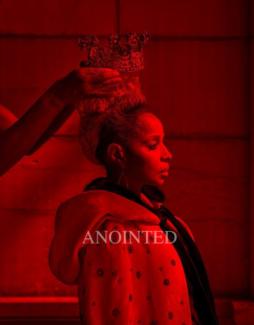 Image info: Carrie Mae Weems Anointed, 2017. Image credit: Courtesy the artist and Jack Shainman Gallery, New York. Woman in cape with crown being placed upon head - photo awash with red.